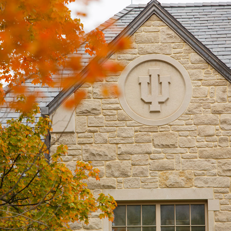The IU logo on an exterior wall of the Hutton Honors College building