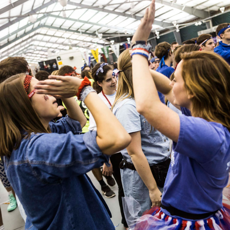 Two students give a high five at the IU Dance Marathon.