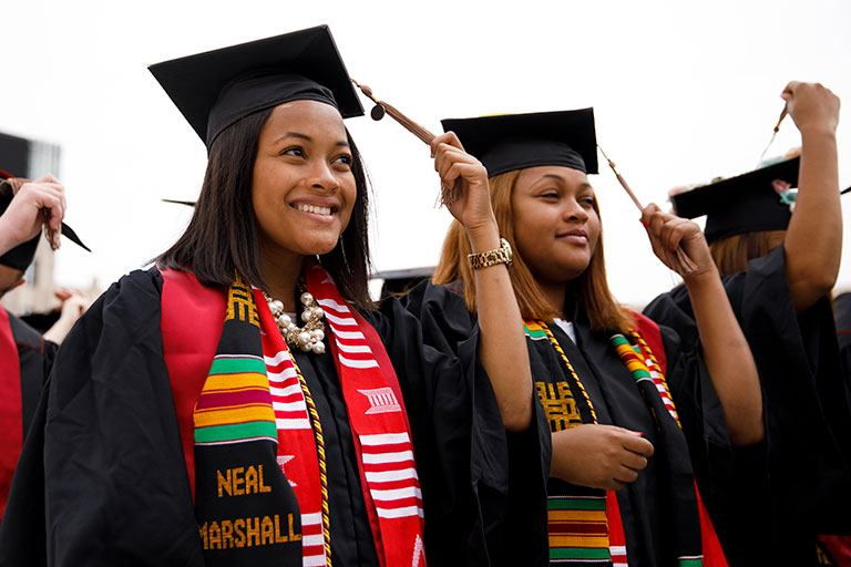 Mica and Maya Caine turn their tassels during the IU Bloomington commencement ceremony.