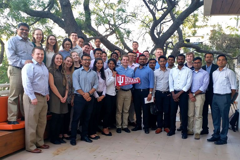 Group of students with an IU pennant in India.