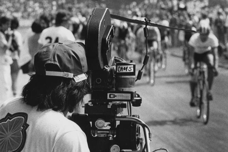A film crew films a bicycle race scene for Breaking Away.