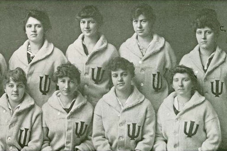 A historical photo of women wearing IU athletics jackets