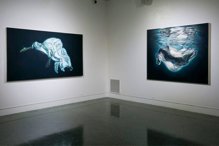 Two oil paintings from Ana Teresa Fernández' Of Bodies and Borders exhibition