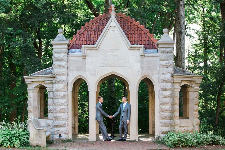 A couple holds hands at the Rose Well House.