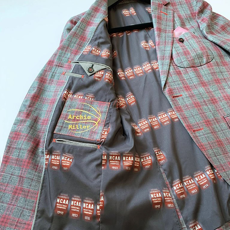 A bespoke plaid jacket with NCAA championship banners printed on the lining