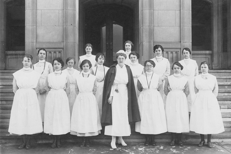 Historic portrait of IU nursing faculty with students.