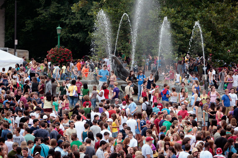 A large group of students gather around Showalter Fountain during IU's CultureFest.