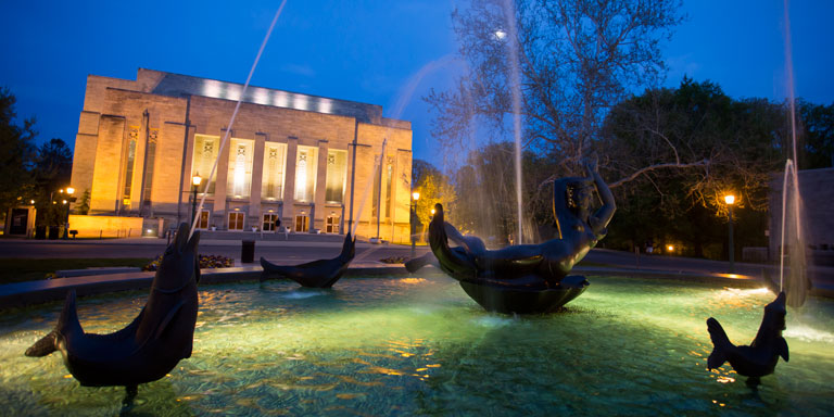 The IU Auditorium and Showalter Fountain at night
