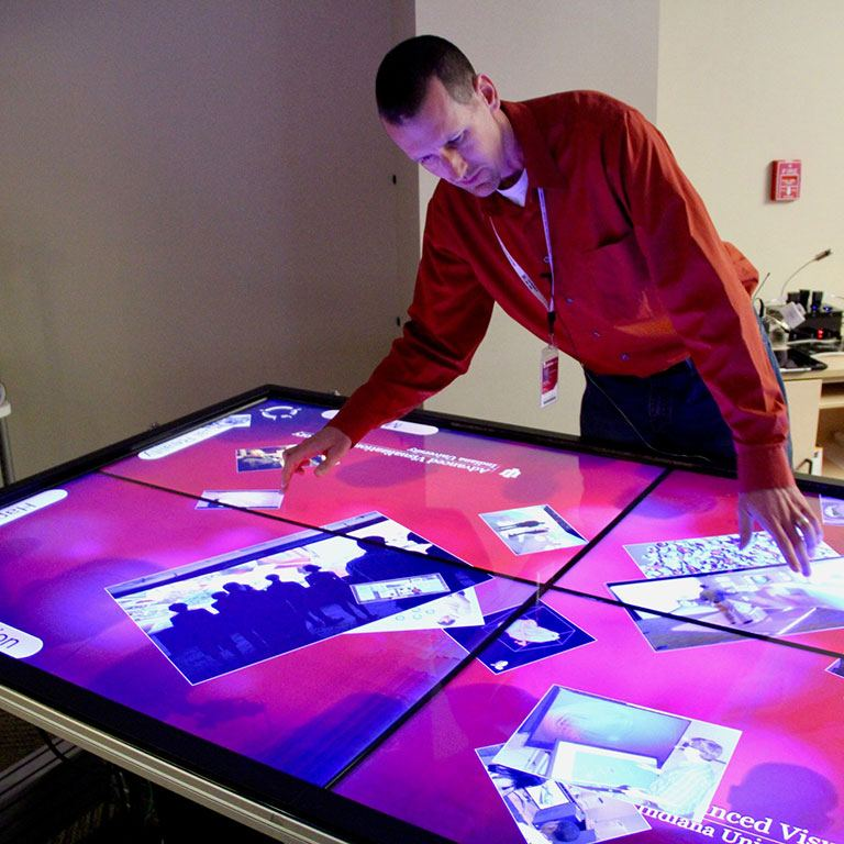 Mike Boyles demonstrates the Advanced Visualization Lab's IQ Table.